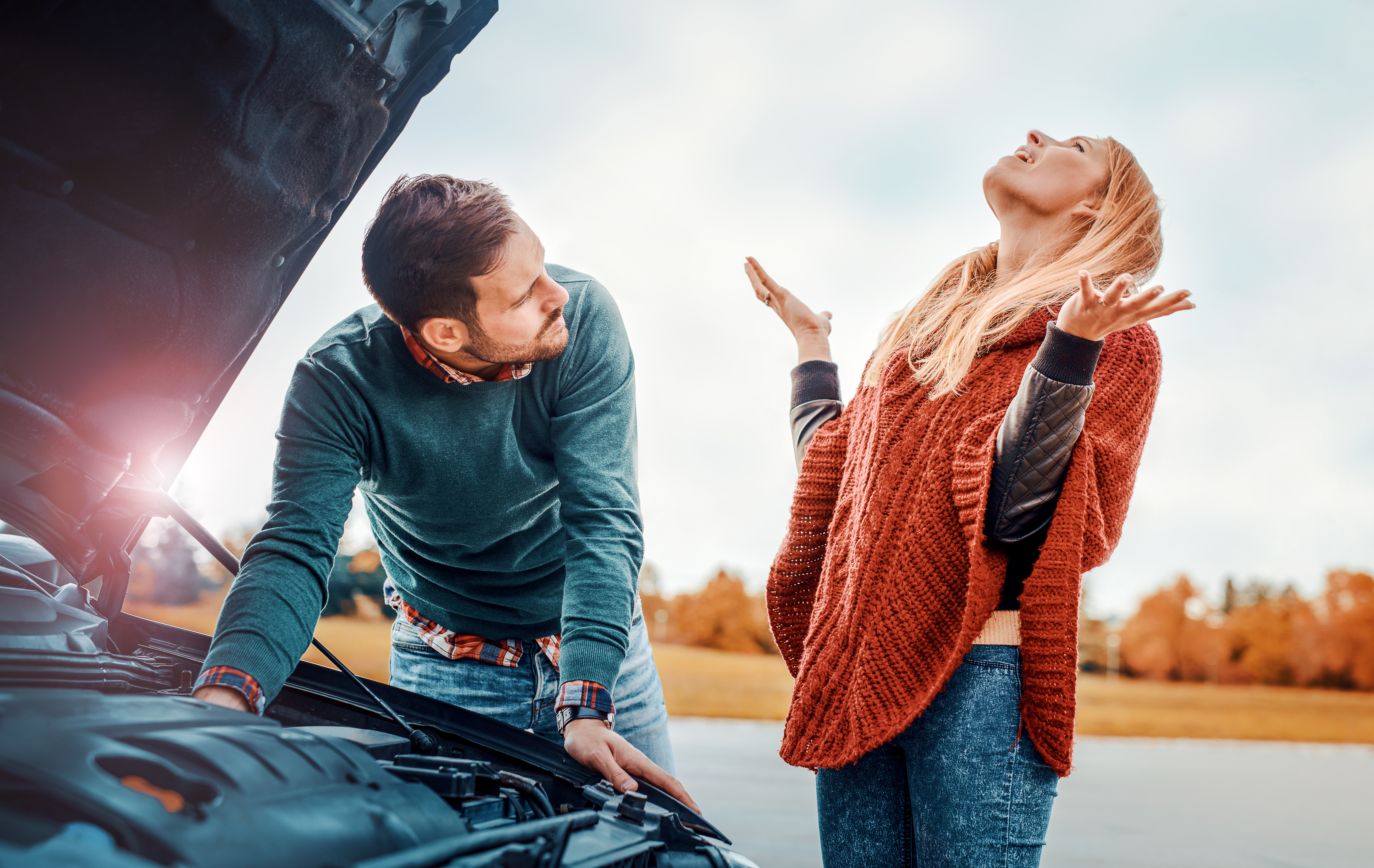 Man and Woman with Broken Down Car on Highway
