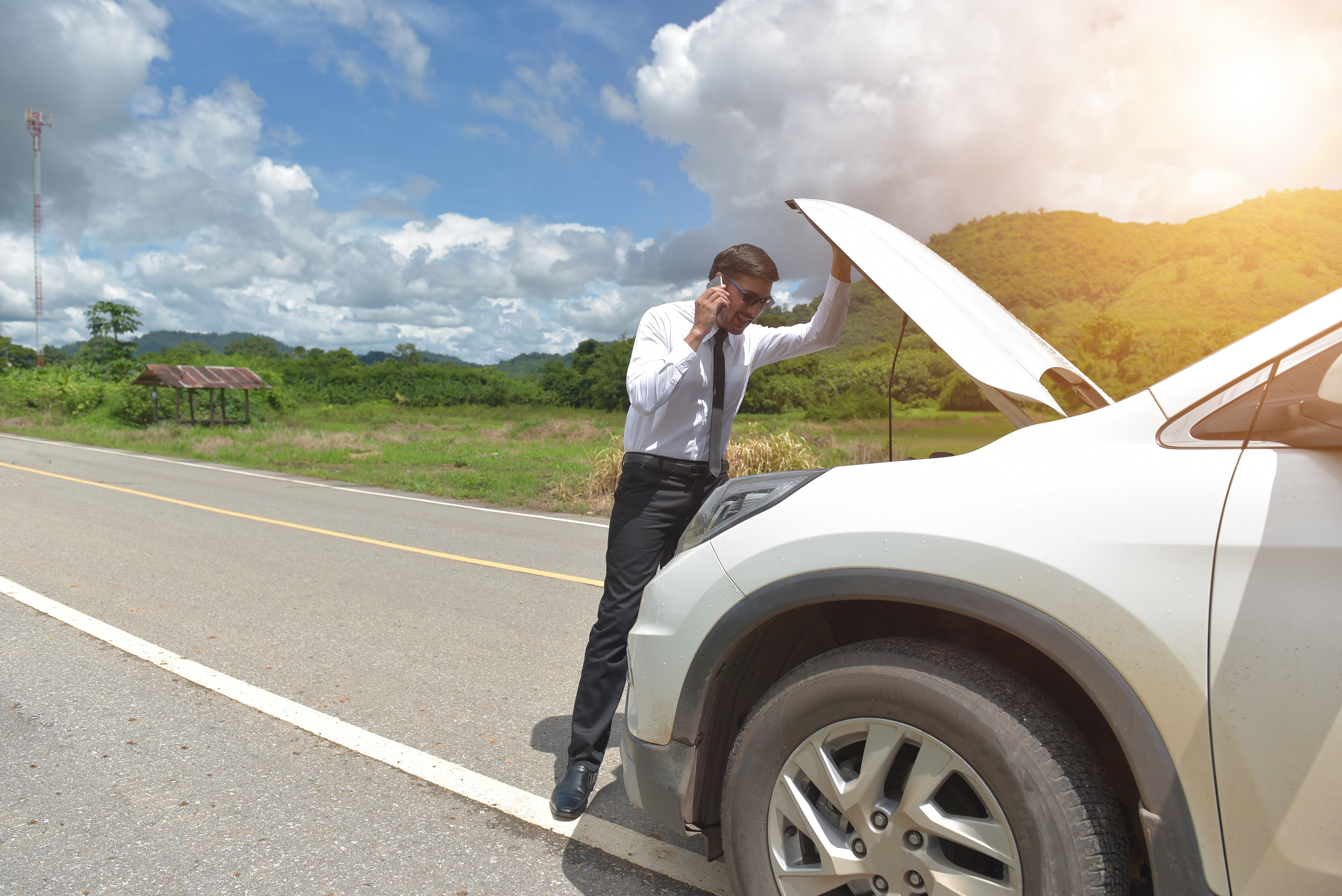 Man with broken down vehilce on highway